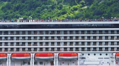 People activity on decks of cruise liner MSC Orchestra while moored in Bay of Stock Footage