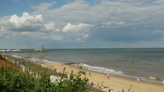 Coastal view of Southwold Beach with Pier in Background Stock Footage