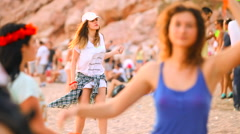 Young women dancing on the electronic beach party by the sea Stock Footage