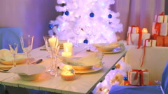 Beautifully decorated white table for Christmas Eve Stock Footage