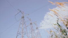 Electrical pylons. Sky, clouds and grass on background. Timelapse Stock Footage