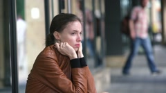 Beautiful young woman into despair and sadness on a city street Stock Footage