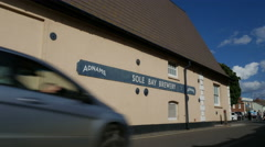 Tourists passing Adnams Sole Bay Brewery, Southwold Stock Footage