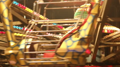 Amusement park attraction ferris wheel carousel swing. Night evening Stock Footage