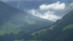 Spectacular alpine mountains and flying clouds Stock Footage