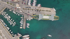Aerial view of docked ferry boat in the port - Mediterranean sea Stock Footage