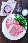 Raw meat with spice on white plate and on a table Stock Photos