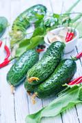 Fresh cucumbers with salt and spice on the wooden table Stock Photos