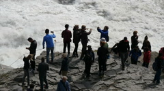 Tourists at the Gullfoss waterfall, Iceland, slowmo Stock Footage