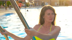 Beautiful model posing for the camera in the pool. HD Stock Footage