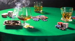Dealing cards in a poker on table with a cigar and whiskey Stock Footage