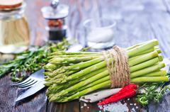 Raw asparagus with salt and aroma spice on a table Stock Photos
