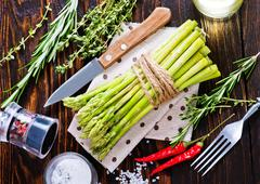 Raw asparagus with salt and aroma spice on a table Stock Photos