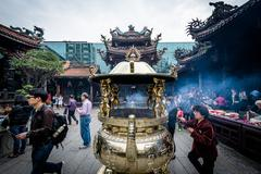 The burning of incense sticks, at Longshan Temple in the Wanhua District of T Stock Photos