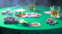 Cigar and whiskey on a table after the game of poker Stock Footage