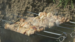 Kebabs are roasted on the metal skewers on coals Stock Footage