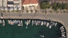 Aerial view of cozy mediterranean village port - Croatia, Brac island Stock Footage