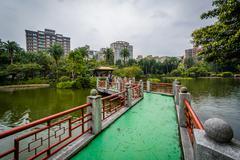 Walkway and pond at Zhongshan Park, in Taipei, Taiwan. Stock Photos