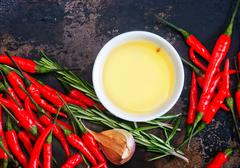 Red hot chilli with salt and aroma spice on a table Stock Photos