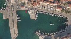 Aerial shot of mediterranean city port - Croatia, Brac island Stock Footage