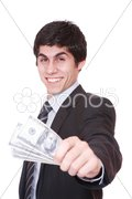 Businessman holding batch of dollars Stock Photos