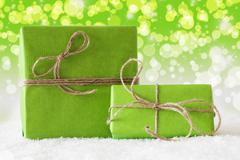 Two Gifts On Snow, Green Bokeh Effect Stock Photos
