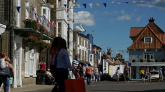 Visitors and tourists passing the Market Place, Southwold Stock Footage