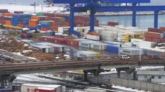 Wide shot of container terminal of trading port in winter time Stock Footage