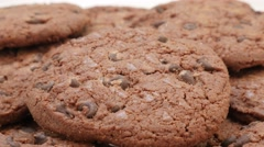 Tasty looking chocolate cookie cake biscuits pile close-up slow tilt Stock Footage