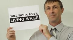 Businessman Will Work For Living Wage Sign Stock Photos