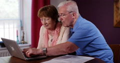 4k, Retired man and his wife going through documents, worried about savings Stock Footage