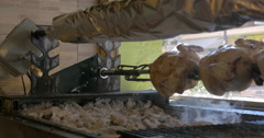 Grilled chicken cooked on the skewer Stock Footage