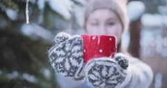 Woman Gives Cup of Hot Drink, Enjoying Snowy Winter Morning. 4K SLOW MOTION Stock Footage