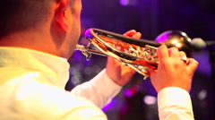 Musician plays trumpet in concert at night close up Stock Footage