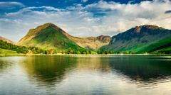 Stunning sunset over the lake and mountains in the Lake District, 4k, timelapse Stock Footage