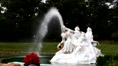 Water fountain with a sculptor of women in a park Stock Footage