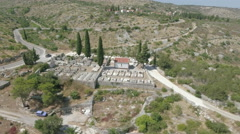 Aerial view of mediterranean cemetery between the mountains Stock Footage