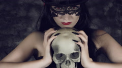 4k Halloween Shot of a Witch Holding Angry a Skull Stock Footage