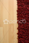 Rug on laminate floor Stock Photos