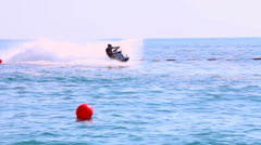 Man driving a scooter at race on the sea sea Stock Footage