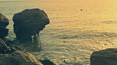 Waves on the Rocks, Waves on Cliffs in Sunrise. Slow motion Stock Footage