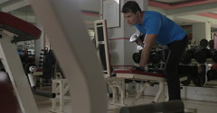 At the gym young man doing exercise for triceps Stock Footage