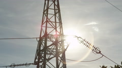 CLOSE UP: Steel transmission tower and high voltage power lines behind the tree Stock Footage