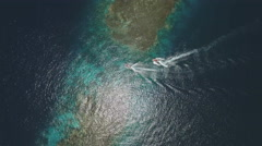 Aerial view of the motorboats pass over coral reef gangway - Shaab Rumi, Red Sea Stock Footage