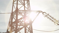CLOSE UP: High voltage steel transmission tower and power lines on sunny day Stock Footage