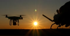 Aerial multirotor drone quadcopter aircraft flying in sky via remote control Stock Footage