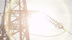 CLOSE UP: High voltage metal transmission tower and power lines on sunny day Stock Footage