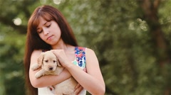 Girl irons a little puppy Stock Footage