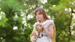 Girl irons a puppy on hands Stock Footage
