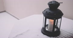 Woman lighting Outdoor Candle Lantern, Cozy Morning. 4K DCi SLOW MOTION 120 fps Stock Footage